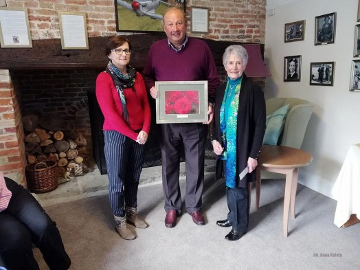 Anna being presented with a photograph of the Sue Ryder rose by Robert Frith, chairman of the LRWMT and Phyllis Felton