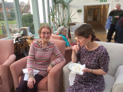 Elizabeth Cheshire sitting with Anne Bolitho who worked in the offices at the Sue Ryder HQ in Cavendish for many years